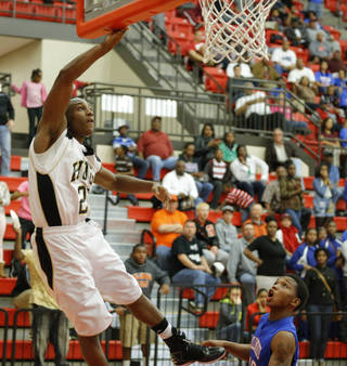 Millwood's Chris Cook watches as Hugo's Trey Johnson makes the game-winning basket for Millwood in a Class 3A boys state basketball tournament game between Hugo and Millwood at Yukon High School in Yukon, Okla., Thursday, March 7, 2013. Photo by Bryan Terry, The Oklahoman