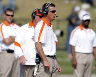Oklahoma State head coach Mike Gundy watches the game during a college football game between the Oklahoma State University Cowboys (OSU) and the University of Missouri Tigers (Mizzou) at Faurot Field in Columbia, Mo., Saturday, Oct. 22, 2011. Photo by Sarah Phipps, The Oklahoman