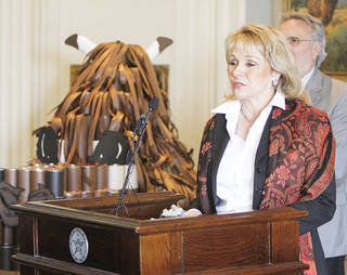Gov. Mary Fallin on Monday announces the results of the third annual Feeding Oklahoma Food and Fund Drive. The drive exceed its goal by raising $359,611 and 823,278 pounds of food. That equates to 2.6 million meals, the governor's office reported. The goal of the drive was to generate 1.2 million meals. PHOTO BY PAUL HELLSTERN, THE OKLAHOMAN PAUL HELLSTERN