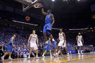 Brendan Haywood (33) of Dallas dunks the ball against the Thunder defense during game 3 of the Western Conference Finals of the NBA basketball playoffs between the Dallas Mavericks and the Oklahoma City Thunder at the OKC Arena in downtown Oklahoma City, Saturday, May 21, 2011. Photo by Chris Landsberger, The Oklahoman