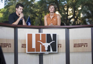 Anchor Lowell Galindo interviews Texas University women's basketball coach Gail Goestenkors, right, during the launch of the Longhorn Network and for the College Game Day live event on the University of Texas at Austin campus, Friday, Aug. 26, 2011, in Austin, Texas. (AP Photo/Austin American Statesman, Ricardo B. Brazziell)