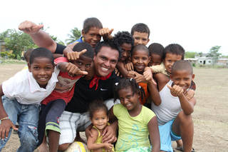 Smiling children surround Edwin Amaya in Cartagena, Colombia. Amaya is the founder of the Smile Colombia Foundation. PHOTO PROVIDED