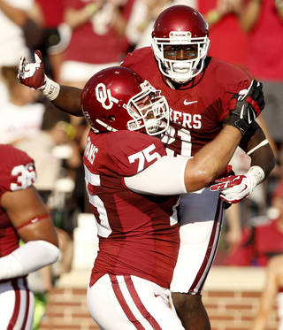 Oklahoma's Keith Ford (21) celebrates with Tyler Evans (75) after scoring a touchdown during a college football game between the University of Oklahoma Sooners (OU) and the Louisiana Tech Bulldogs at Gaylord Family-Oklahoma Memorial Stadium in Norman, Okla., on Saturday, Aug. 30, 2014. Photo by Bryan Terry, The Oklahoman
