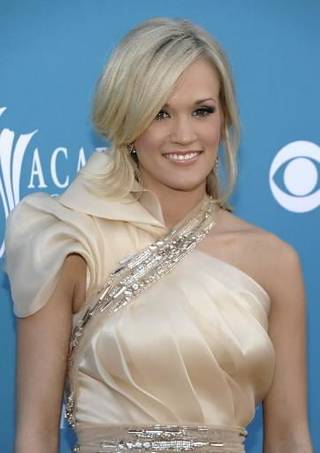 Carrie Underwood arrives at the 45th Annual Academy of Country Music Awards in Las Vegas on Sunday, April 18, 2010. AP Photo