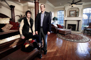 Megan and Kurt Dinnes, outgoing Central Oklahoma Home Builders Association president, show the master suite at their home in Norman. Photo by STEVE SISNEY, THE OKLAHOMAN