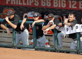 OKLAHOMA STATE UNIVERSITY / COLLEGE BASEBALL / REACTION: OSU reacts after losing to Texas during their Big 12 tournament game between Oklahoma State and Texas at RedHawks Field at Bricktown in Oklahoma City, Friday, May 27, 2011. Photo by Sarah Phipps, The Oklahoman ORG XMIT: KOD