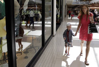 Anneka Johnson, of Estonia, walks with her son while shopping at Aventura Mall, in Aventura, Fla. AP Photo Lynne Sladky - AP