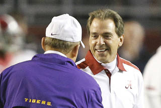 Alabama head coach Nick Saban right, speaks with LSU head coach Les Miles before an NCAA college football game Saturday, Nov. 5, 2011, in Tuscaloosa, Ala. Saban and Miles both voted in the coaches' poll this season. (AP Photo/Butch Dill)