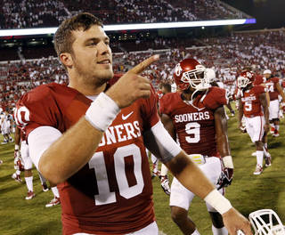 Oklahoma's Blake Bell (10) leaves the field at the end of the game after replacing Trevor Knight in the fourth quarter during a college football game between the University of Oklahoma Sooners (OU) and the West Virginia University Mountaineers at Gaylord Family-Oklahoma Memorial Stadium in Norman, Okla., on Saturday, Sept. 7, 2013. Photo by Steve Sisney, The Oklahoman