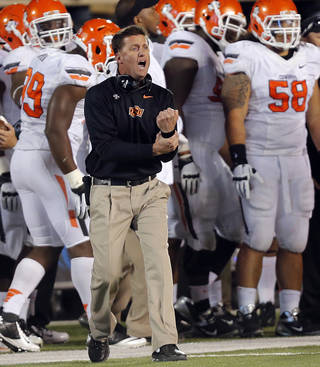 Mike Gundy yells at the officials about holding at the line of scrimmage during the college football game between the Oklahoma State University Cowboys (OSU) and the Texas Tech University Red Raiders (TTU) at Jones AT&T Stadium in Lubbock, Tex. on Saturday, Nov. 2, 2013. Photo by Chris Landsberger, The Oklahoman