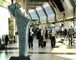 """Two bronze sculptures by Chiricahua Apache artist Allan Houser have been installed at Will Rogers World Airport in Oklahoma City. Standing eight feet tall and weighing nearly 1,000 pounds, the statue """"Prayer,"""" right, is in the central concourse near the Coffee Bean & Tea Leaf. """"The Future"""" statue is a bit smaller and is on the lower level by Baggage Claim 4. Photo by Jim Beckel, The Oklahoman"""