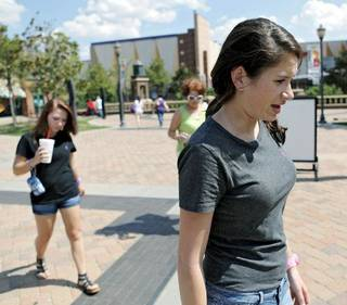Kelsea Hammons, her friend Brittney Campbell (left) and Peggy Hammons (background) talk about the night Kelsea and Brittney were arrested outside Harkins Bricktown Theater in Oklahoma City on Tuesday, July 19, 2011. Photo by John Clanton, The Oklahoman ORG XMIT: KOD