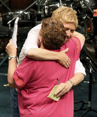 TORNADO AFTERMATH: State superintendent Janet Barresi, back, hugs Moore Public Schools superintendent Susan Pierce during a districtwide meeting of Moore Public Schools employees at Southern Hills Baptist Church, 8601 Pennsylvania Ave., in Oklahoma City, Wednesday, May 22, 2013, after a tornado struck south Oklahoma City and Moore, Okla., on Monday. Photo by Nate Billings, The Oklahoman