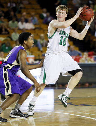 Bishop McGuinness' Greg Roberts (10) looks to pass away from Chickasha's Deshawn Young (21) during a Class 5A boys high school basketball game in the semifinals of the state tournament at the Mabee Center in Tulsa, Okla., Friday, March 8, 2013. Photo by Nate Billings, The Oklahoman