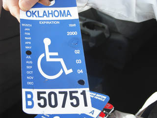 David Hoff, civilian officer for the Handicap Parking Enforcement Specialist program, holds bogus handicap parking placards he confiscated. PHOTO BY VALLERY BROWN, THE OKLAHOMAN Steven Stokes Director, Oklahoma Office of Disability Concerns