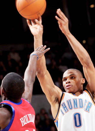 Oklahoma City's Russell Westbrook, right, puts up a shot in front of Philadelphia's Jrue Holiday during the second half at the Ford Center on Wednesday. Photo By John Clanton, The Oklahoman