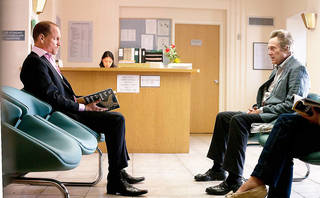 "Woody Harrelson, left, and Christopher Walken in a scene from ""Seven Psychopaths."" CBS FILMS PHOTO Chuck Zlotnick"