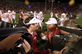 U coach Bob Stoops and OSU coach Les Miles meet after the 2001 Bedlam game at mid-field. Photo by Doug Hoke, The Oklahoman Archive