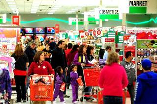 Shoppers maneuver through the crowds at Target to catch the day-after-Christmas holiday deals on Monday in Abilene, Texas. AP PHOTO Joy Lewis