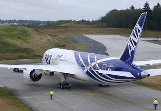 The first Boeing Co. 787 plane delivered to a commercial customer taxis for take off to Japan, Tuesday, Sept. 27, 2011, in Everett, Wash. The plane will be operated by Japan's All Nippon Airways. (AP Photo/Ted S. Warren) ORG XMIT: WATW111
