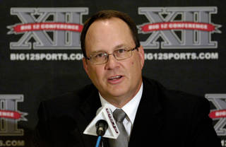FILE - This July 27, 2010, file photo shows Big 12 commissioner Dan Beebe addressing the media during a news conference at the Big 12 Football Media Day, in Irving, Texas. An Associated Press analysis of tax records shows that four of college football's six powerhouse conferences that form the core of the BCS paid their top executives $1 million or more. In 2009, the most recent for which records are available, Big Ten commissioner Jim Delany is the highest paid at $1.6 million. He is followed by Atlantic Coast Conference commissioner John Swofford ($1.1 million), Southeastern Conference commissioner Mike Slive ($1 million) and Big 12 commissioner Dan Beebe ($997,000). (AP Photo/Cody Duty) ORG XMIT: NY165