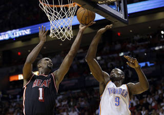 Miami Heat center Chris Bosh goes to the basket as Serge Ibaka defends during the teams' first matchup in Miami. AP Photo