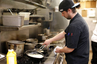 Chef Henry Boudreaux pan-sears scallops in the kitchen of The Museum Cafe in Oklahoma City. SARAH PHIPPS - SARAH PHIPPS