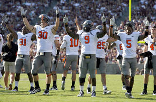 Oklahoma State celebrates a touchdown in the second half during a college football game between the Oklahoma State Cowboys (OSU) and the Texas A&M Aggies at Kyle Field in College Station, Texas, Saturday, Sept. 24, 2011. Photo by Sarah Phipps, The Oklahoman