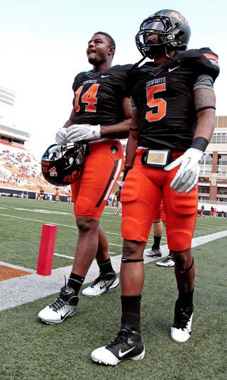 Oklahoma State's Justin Horton (14) and Josh Stewart (5) warm up before the college football game between the Oklahoma State University Cowboys (OSU) and the University of Kansas Jayhawks (KU) at Boone Pickens Stadium in Stillwater, Okla., Saturday, Oct. 8, 2011 Photo by Steve Sisney, The Oklahoman