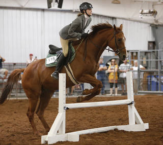 Lauren Saxon, riding Charlotte, jumps a hurdle in the Working Hunter Class during the Cleveland County Free Fair Horse Show. PHOTO BY STEVE SISNEY, THE OKLAHOMAN STEVE SISNEY -