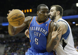 Oklahoma City Thunder's Kendrick Perkins, left, drives around Minnesota Timberwolves' Nikola Pekovic, of Montenegro, in the second half of an NBA basketball game, Friday, March 29, 2013 in Minneapolis. Pekovic led the Timberwolves with 22 points and 15 rebounds in their 101-93 win. (AP Photo/Jim Mone) ORG XMIT: MNJM106