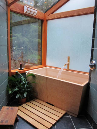 In this undated photo released from WoodenTubs.com, the Sea Otter Woodworks' Kyoto soaking tub, or ofuro, made of fragrant Hinoki cypress, is shown. (AP Photo/WoodenTubs.com)
