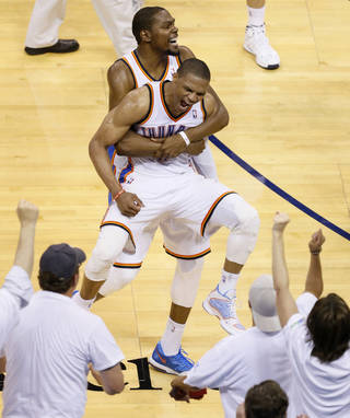 Oklahoma City's Russell Westbrook (0) and Kevin Durant (35) celebrate after winning Game 5 of the Western Conference semifinals in the NBA playoffs between the Oklahoma City Thunder and the Los Angeles Clippers at Chesapeake Energy Arena in Oklahoma City, Tuesday, May 13, 2014. Photo by Bryan Terry, The Oklahoman