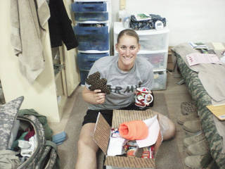 Military service member Katie Fichtner receives a care package from The Hugs Project. - photo provided