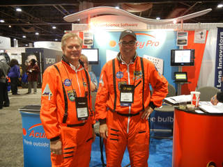 Jerry Carter, left, and Dan Bintz, business partners in Acuity Pro vision-science software, pose wearing NASA jumpsuits at a recent optometry meeting trade show in Atlanta. PHOTO PROVIDED