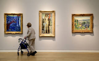 A woman browses various impressionistic paintings during a preview exhibition for Sotheby's Spring Evening Sale of impressionistic and modern art in New York. AP File Photo Julie Jacobson