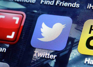 A Twitter app on an iPhone screen is shown in this photo, in New York. AP File Photo Richard Drew - AP