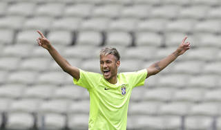 Brazil's Neymar smiling as he holds out his arms during a training session at the Arena Castelao in Fortaleza, Brazil. AP Photo Andre Penner - AP