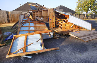 Storage building leveled by a storm at the Episcopal Church of the Resurrection, 13112 N. Rockwell Blvd., in Oklahoma City Tuesday, Aug. 9, 2011. A thunderstorm moved through the area Monday evening causing storm damage. Photo by Paul B. Southerland, The Oklahoman