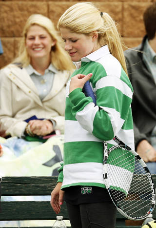 Bishop McGuinness' Madison Schick, right, takes a break during a Class 6A #2 Doubles match as her twin sister, Morgan Schick, who is also a tennis player for McGuinness, watches during the girls high school state tennis tournament at the Oklahoma City Tennis Center in Oklahoma City, Saturday, May 4, 2013. Photo by Nate Billings, The Oklahoman