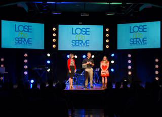 Jessica Patterson Rimmer, Mid America Christian University's dean of student life, and Cody Bobay, founder of Lose to Serve, present a Mid America Presidential Scholarship to Bryanna Weaver, 18, a member of Westmoore Community Church, during the recent Lose to Serve Church Challenge Celebration at the church, 12609 S Western. PHOTO PROVIDED