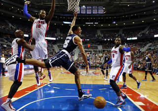 Oklahoma City Thunder guard Thabo Sefolosha (25) loses the ball driving on Detroit Pistons guard Chauncey Billups (1), Greg Monroe (10) and Andre Drummond (0) in the first half of an NBA basketball game in Detroit, Friday, Nov. 8, 2013. (AP Photo/Paul Sancya)