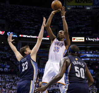 Oklahoma City's Kevin Durant (35) shoots the ball from between Memphis' Marc Gasol (33) and Zach Randolph (50) during Game 5 in the second round of the NBA playoffs between the Oklahoma City Thunder and the Memphis Grizzlies at Chesapeake Energy Arena in Oklahoma City, Wednesday, May 15, 2013. Memphis won 88-84. Photo by Bryan Terry, The Oklahoman
