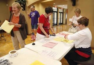 Edmond citizens sign in to vote at the Spring Creek Assembly of God Church in Edmond, OK, Tuesday, June 24, 2014, Photo by Paul Hellstern, The Oklahoman