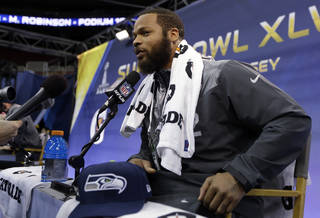 Seattle Seahawks' Michael Bowie answers a question during media day for the NFL Super Bowl XLVIII football game Tuesday, Jan. 28, 2014, in Newark, N.J. (AP Photo/Jeff Roberson)