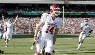 OU's Sam Bradford celebrates after running for a touchdown during the college football game between the University of Oklahoma and Texas A&M University at Kyle Field in College Station, Texas, Saturday, November 8, 2008. BY BRYAN TERRY, THE OKLAHOMAN