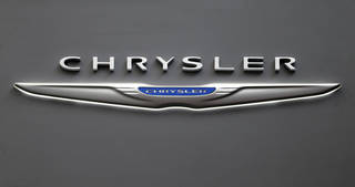 The Chrysler logo on a sign at the 2013 Pittsburgh Auto Show in Pittsburgh. AP File Photo Gene J. Puskar - AP