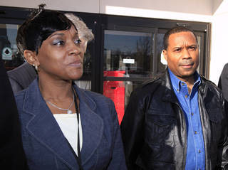 Oklahoma County District Judge Tammy Bass-LeSure, left, and husband Karlos LeSure, right, leave the Oklahoma County Jail after turning themselves in this morning to be fingerprinted and have their photos taken in Oklahoma City Monday, Jan. 24, 2011. Photo by Paul B. Southerland