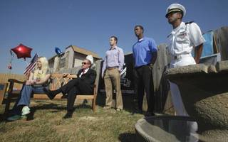 Jennifer Hunt, widow of Spc. Jason D. Hunt; Reggie Whitten, Pros for Vets/Pros for Africa; Landry Jones and Julian Wilson, University of Oklahoma football players: and James Smith appear at the dedication of Quinton Carter's charity educational garden at a KinderCare on Friday, March 25, 2011, in Norman, Okla. Photo by Steve Sisney, The Oklahoman STEVE SISNEY