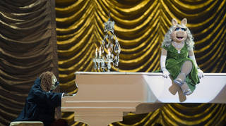 """This image released by Disney shows Rowlf, left, and Miss Piggy in a scene from """"Muppets Most Wanted."""" AP Photo/Disney, Jay Maidment Jay Maidment -"""